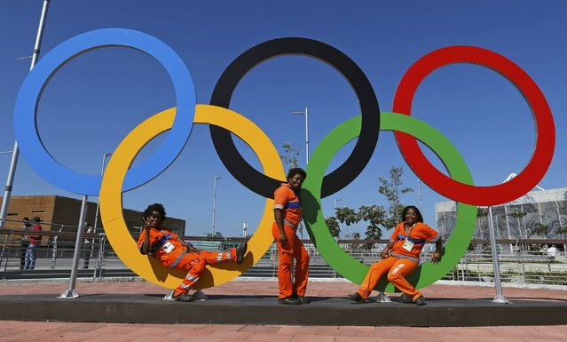 Three cleaners pose in the rings at the Olympic Park in Rio de Janeiro, Brazil August 1, 2016. (Photo by Sergio Moraes/Reuters)