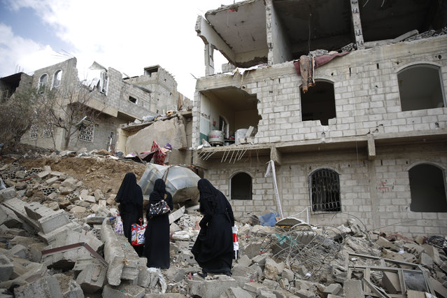 Women walk through the rubble of houses damaged by a Saudi-led airstrike in Sanaa, Yemen, Monday, September 7, 2015. (Photo by Hani Mohammed/AP Photo)