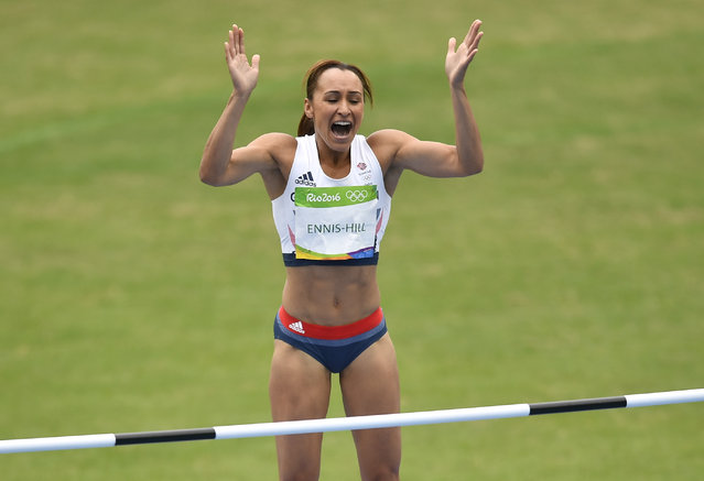 Britain's Jessica Ennis-Hill celebrates in a heat of the women's heptathlon high jump during the athletics competitions of the 2016 Summer Olympics at the Olympic stadium in Rio de Janeiro, Brazil, Friday, August 12, 2016. (Photo by Martin Meissner/AP Photo)