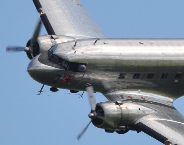 Dakota Norway Douglas DC-3C LN-WND – Flying Legends Airshow 2021 Duxford. The Douglas DC-3 is an American fixed-wing propeller-driven airliner, the speed and range of which revolutionized air transport in the 1930s and 1940s. Its lasting impact on the airline industry and World War II makes it one of the most significant transport aircraft ever made. The major military version was designated the C-47 Skytrain, of which more than 10,000 were produced. Many DC-3 / C-47s are still used in all parts of the world. The DC-3 was the culmination of a development effort that originated out of an inquiry from Transcontinental and Western Airlines (TWA) to Donald Douglas. TWA's rival in transcontinental air service, United Airlines, was inaugurating service with the Boeing 247 and Boeing refused to sell any 247s to other airlines until United's order for 60 aircraft had been filled. TWA asked Douglas to design and build an aircraft that would enable TWA to compete with United. Douglas' resulting design, the 1933 DC-1, was promising, and led to the DC-2 in 1934. While the DC-2 was a success, there was still room for improvement. (Rob Lovesey)