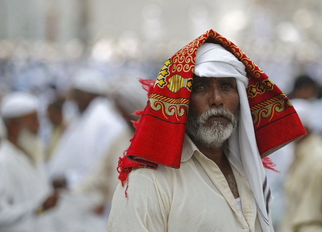 A Muslim pilgrim is seen with his prayer mat on his head as he leaves after attending Friday prayers outside the Grand mosque in the holy city of Mecca ahead of the annual haj pilgrimage, September 18, 2015. (Photo by Ahmad Masood/Reuters)