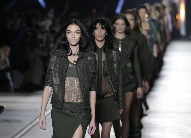 Models wear creations for Versace women's Spring-Summer 2016 collection, part of the Milan Fashion Week, unveiled in Milan, Italy, Friday, September 25, 2015. (Photo by Antonio Calanni/AP Photo)