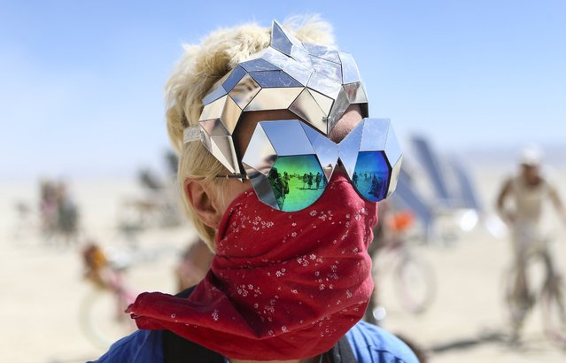 Vita Kamliuk of Russia poses for a photo during Burning Man at the Black Rock Desert north of Reno, Nev., Thursday, September 1, 2016. (Photo by Chase Stevens/Las Vegas Review-Journal via AP Photo)