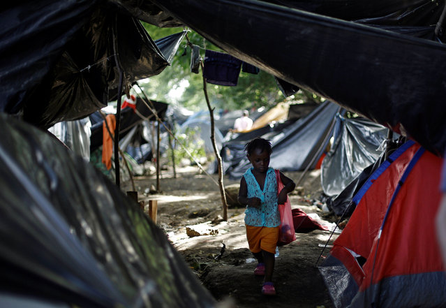 An African migrant child walks in a makeshift camp at the border between Costa Rica and Nicaragua, in Penas Blancas, Costa Rica, September 8, 2016. (Photo by Juan Carlos Ulate/Reuters)