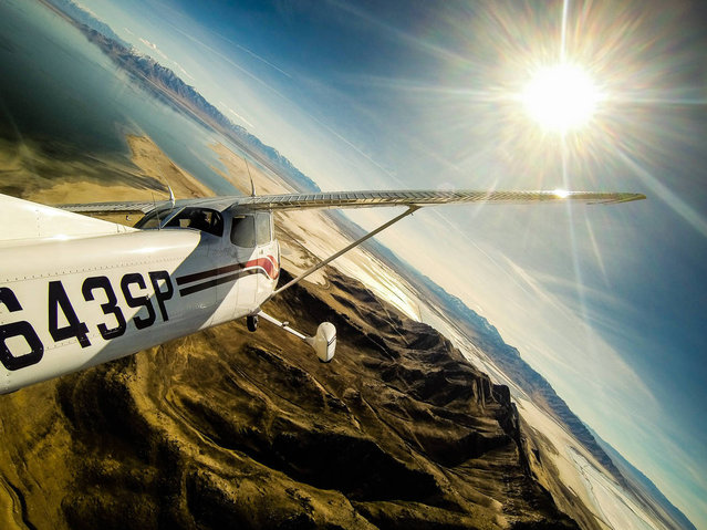 """Flying over Salt Lake by Tom Wallisch. Flying over Salt Lake and Stansbury Island today with @WileyMiller behind the wheel"". (Photo by Tom Wallisch)"