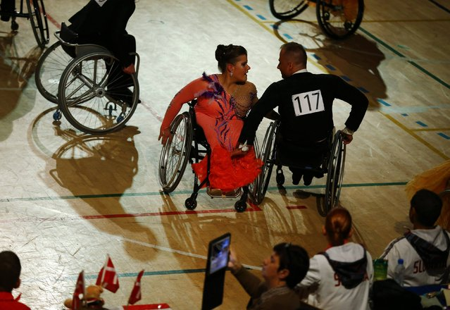 Pawel Karpinski and Joanna Reda of Poland dance during IPC Wheelchair Dance Sport European Championships in Lomianki near Warsaw, November 9, 2014. (Photo by Kacper Pempel/Reuters)