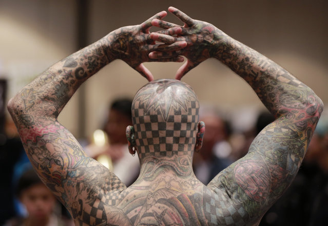 "Matt Gone, known as ""Checkered Man"", poses for a photo at a during the VIII International Tattoo Artist Convention in Bogota, Colombia, Saturday, November 15, 2014. (Photo by Fernando Vergara/AP Photo)"