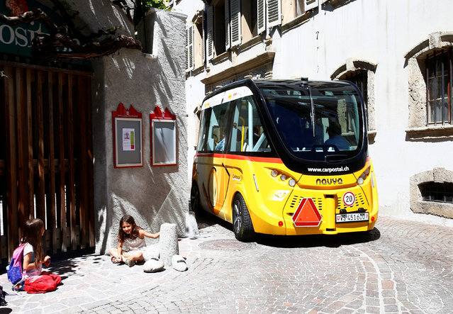 The first autonomous and electric shuttle of PostAuto Schweiz in the old village of Sion, Switzerland, June 2016. (Photo by Ruben Sprich/Reuters)