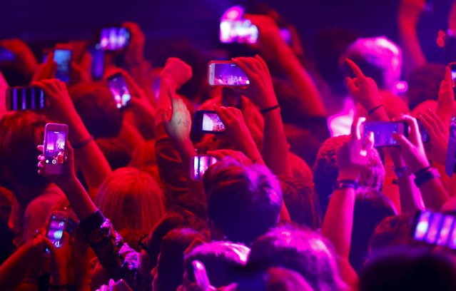 Audience members use their phones during the MTV EMA awards at the Assago forum in Milan, Italy, October 25, 2015. (Photo by Stefano Rellandini/Reuters)