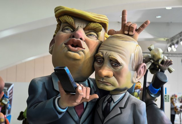 A Ninot, a doll depecting a celebrity that will be set alight during the Fallas festival, representing US President Donald Trump and Russian President Vladimir Putin is displayed in Valencia on March 09, 2018. Fallas are gigantic structures made of cardboard portraying current events and presonalites in which individual figures or Ninots are placed. The Fallas will be burnt in the streets of Valencia on March 19, 2018 as a tribute to Saint Joseph, patron saint of the carpenters' guild. (Photo by Jose Jordan/AFP Photo)