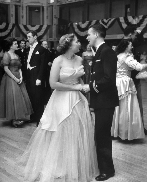 """""""Now down to 155 pounds, an attractive Dorothy dances at Navy Ball"""". (Photo by Martha Holmes/Time & Life Pictures)"""