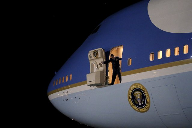 An Air Force personnel opens the door of the the Air Force One as U.S. President Barack Obama arrive at Joint Base Andrews from New Jersey and New York, in Maryland November 2, 2015. (Photo by Carlos Barria/Reuters)
