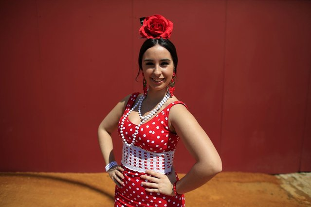 Maria, 18, wearing a traditional Sevillana outfit, poses for a portrait during the traditional Feria de Abril (April fair) in the Andalusian capital of Seville April 16, 2013. (Photo by Marcelo del Pozo/Reuters)