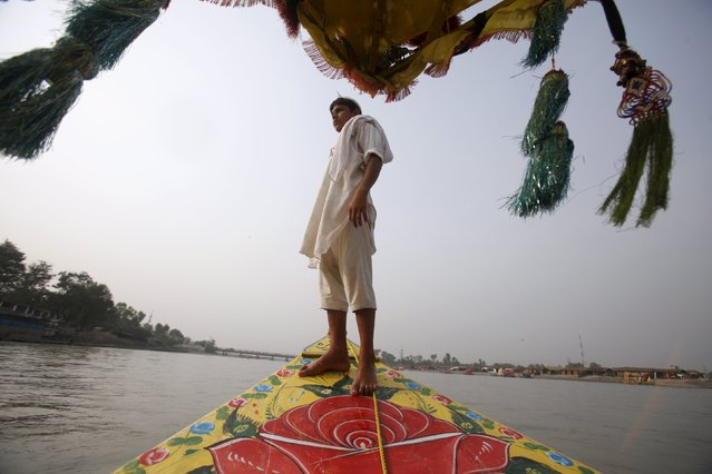 A sailor stands on the bow of his tourist boat in the Sardaryab River at Charsadda, on the outskirts of Peshawar, Pakistan October 13, 2015. (Photo by Fayaz Aziz/Reuters)