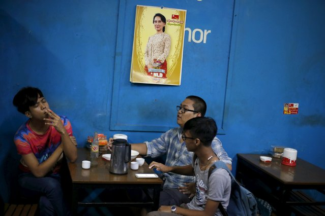 Men sit in a tea house under a calendar with a picture of Myanmar opposition leader Aung San Suu Kyi, in Yangon November 6, 2015. (Photo by Jorge Silva/Reuters)