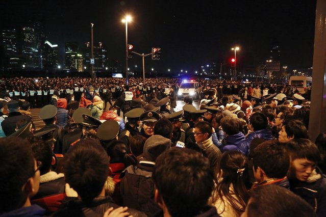 Police control the site after a stampede occurred during a New Year's celebration on the Bund, a waterfront area in central Shanghai, January 1, 2015. (Photo by Reuters/Stringer)