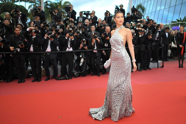 """US model Bella Hadid poses as she arrives on May 14, 2018 for the screening of the film """"BlacKkKlansman"""" at the 71st edition of the Cannes Film Festival in Cannes, southern France. (Photo by Loic Venance/AFP Photo)"""