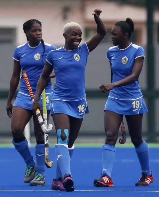 Boyce Keisha (C) of Barbados celebrates a goal against Peru with teammates Best Shani (L) and Wilson Ayanna during their women's International Field Hockey tournament match Rio de Janeiro, Brazil, November 25, 2015. The International Field Hockey tournament is a test event for the Rio 2016 Olympic Games. (Photo by Sergio Moraes/Reuters)