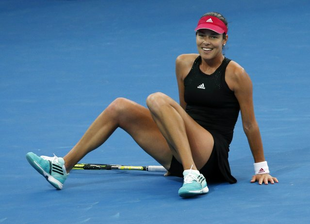 Ana Ivanovic of Serbia laughs as she slips on the court following a return shot to Varvara Lepchenko of the U.S. during their women's singles semi final match at the Brisbane International tennis tournament in Brisbane, January 9, 2015. (Photo by Jason Reed/Reuters)