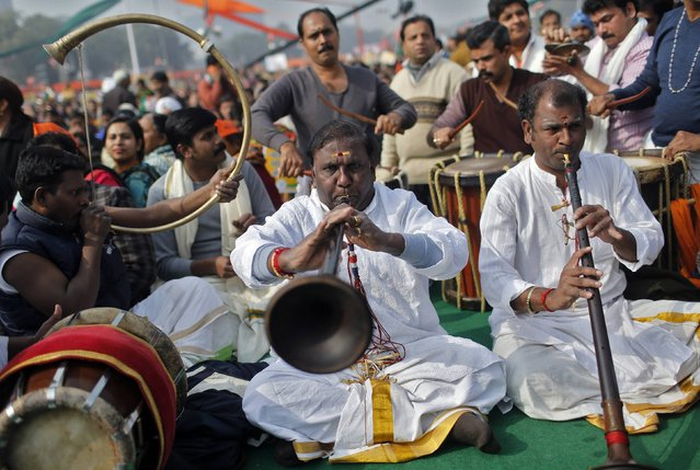 Indian musicians perform upon the arrival of Indian Prime Minister Narendra Modi (not pictured) during a campaign rally ahead of state assembly elections, at Ramlila ground in New Delhi January 10, 2015. (Photo by Anindito Mukherjee/Reuters)