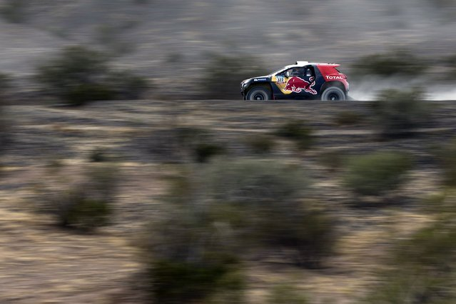 Peugeot driver Cyril Despres of France drives during the 3rd stage of the Dakar Rally 2015, from San Juan to Chilecito January 6, 2015. (Photo by Felipe Dana/Reuters)