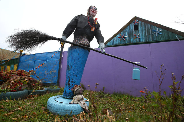 An installation with Baba Yaga, the Witch, an old woman from Russian fairy tales, is seen at a villager's house in the village of Vits, Belarus November 8, 2016. (Photo by Vasily Fedosenko/Reuters)