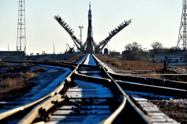 The Soyuz TMA-19M spacecraft is mounted on a launch pad at the Russian-leased Baikonur cosmodrome in Kazakhstan early on December 13, 2015. Russia's Soyuz TMA-19M spacecraft carrying the International Space Station (ISS) Expedition 46/47 crew of Britain's astronaut Tim Peake, Russian cosmonaut Yuri Malenchenko and US astronaut Tim Kopra is scheduled to blast off to the ISS on December 15, 2015. (Photo by Kirill Kudryavtsev/AFP Photo)