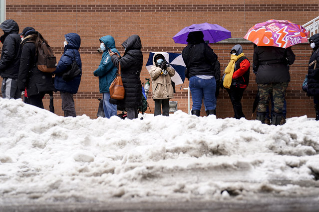 People wait in line at a 24-hour, walk-up COVID-19 vaccination clinic hosted by the Black Doctors COVID-19 Consortium at Temple University's Liacouras Center in Philadelphia, Friday, February 19, 2021. (Photo by Matt Rourke/AP Photo)