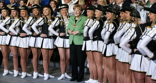 German Chancellor Angela Merkel (C) poses with members of German carnival societies during a reception at the Chancellery in Berlin January 28, 2015. (Photo by Fabrizio Bensch/Reuters)