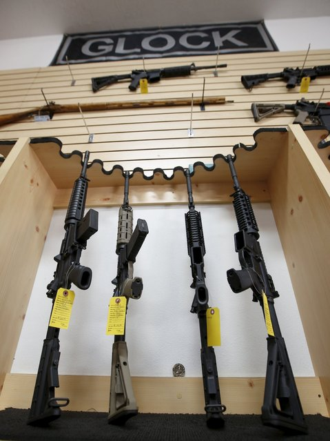 Assault rifles are seen on display for sale at the Ringmasters of Utah gun range and store, in Springville, Utah on December 18, 2015. (Photo by George Frey/Reuters)