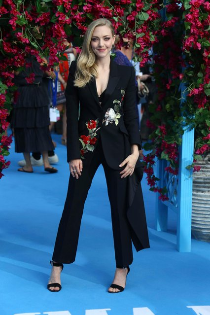 """Actress Amanda Seyfried poses for photographers upon arrival at the World premiere of the film """"Mamma Mia! Here We Go Again"""", in London Monday, July 16, 2018. (Photo by Joel C. Ryan/Invision/AP Photo)"""