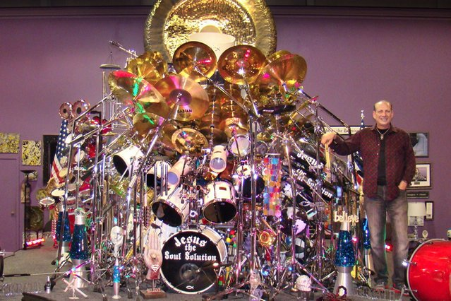 Rock n roll reverend Mark Temperato has smashed the record for the worlds biggest drum kit on July 29, 2013 – with a staggering 813 individual pieces weighing more than a whopping 5000 lbs. (Photo by Caters News)