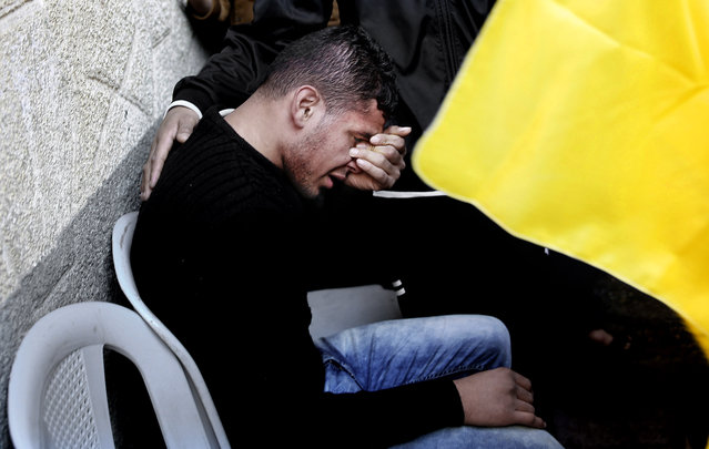 A Palestinian man weeps during them funeral of Hani Wahdan, 22, at his family house in Gaza City, Saturday, December 26, 2015. (Photo by Adel Hana/AP Photo)