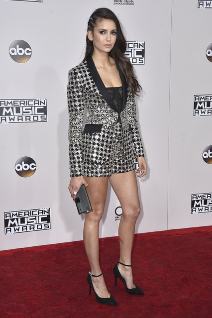 Nina Dobrev arrives at the American Music Awards at the Microsoft Theater on Sunday, November 20, 2016, in Los Angeles. (Photo by Jordan Strauss/Invision/AP Photo)