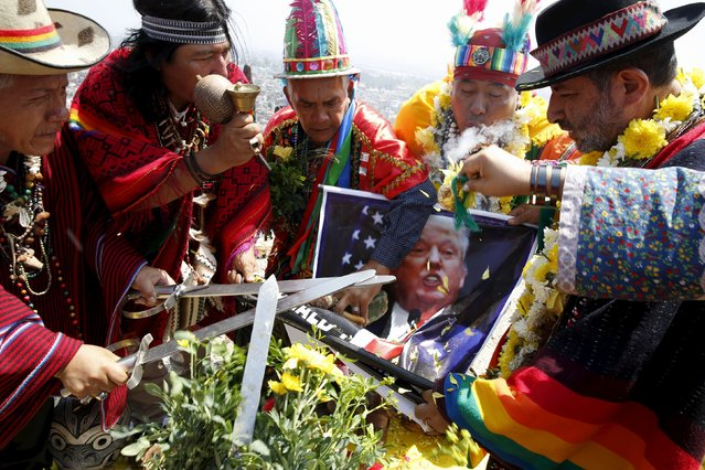 Peruvian shamans holding a poster of U.S. Republican presidential candidate Donald Trump perform a ritual of predictions for the new year at Morro Solar hill in Chorrillos, Lima, Peru, December 29, 2015. (Photo by Mariana Bazo/Reuters)
