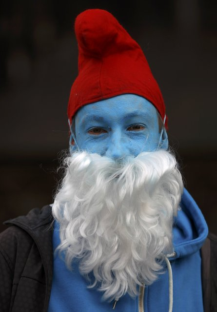 "A man dressed in a costume of a smurf poses at ""Weiberfastnacht"" (Women's Carnival) in Cologne February 12, 2015. (Photo by Ina Fassbender/Reuters)"