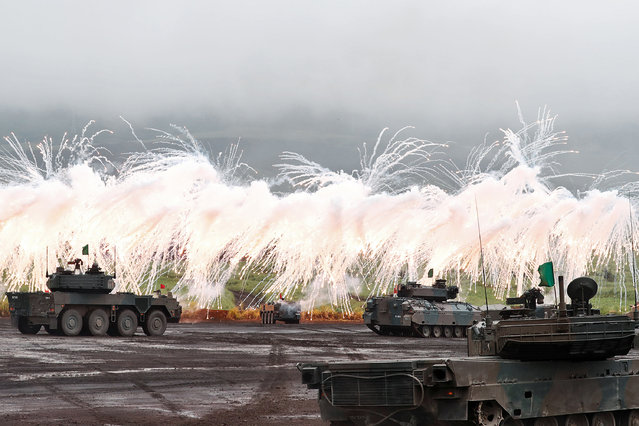 Japanese Ground Self-Defense Force tanks and other armoured vehicles take part in an annual training session near Mount Fuji at Higashifuji training field in Gotemba, west of Tokyo, Japan August 23, 2018. (Photo by Kim Kyung-Hoon/Reuters)