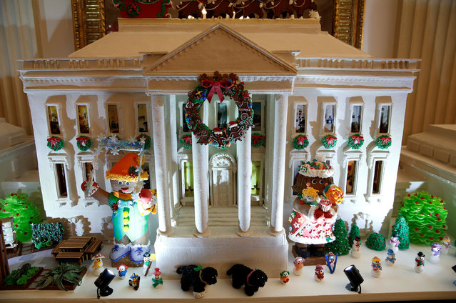 The gingerbread house is on display in the State Dining Room during a holiday decor preview at the White House in Washington, U.S., November 29,  2016. (Photo by Kevin Lamarque/Reuters)