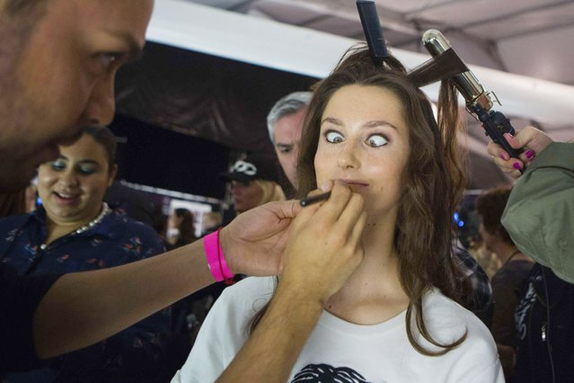 A model makes a face while being made up before the Herve Leger by Max Azria Spring/Summer 2014 collection show during New York Fashion Week, on September 8, 2013. (Photo by Eric Thayer/Reuters)