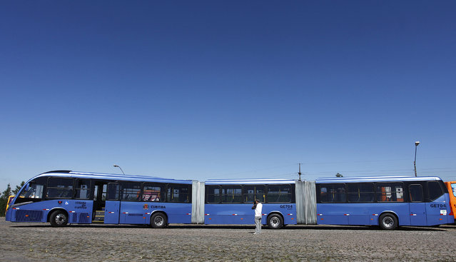 A view of what the Curitiba City Hall is calling the world's longest articulated bus, as it was presented to the press before going into service on the city's public transportation grid, in Curitiba April 5, 2011. The bus, made in Brazil by Volvo with a Neobus chassis, has a capacity of 250 passengers, is 28 meters (92 ft) long, 2.6 meters (8.5 ft) wide, and powered with biodiesel made from soybeans. (Photo by Rodolfo Buhrer/Reuters)