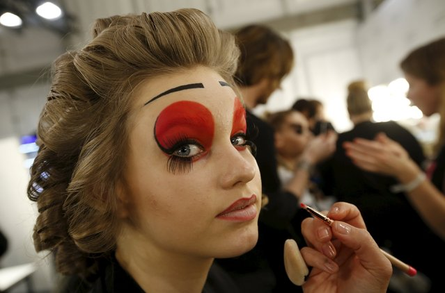 Models prepare backstage before presenting makeup creations during a show by Maybelline New York at the Berlin Fashion Week Autumn/Winter 2016 in Berlin, Germany, January 18, 2016. (Photo by Fabrizio Bensch/Reuters)
