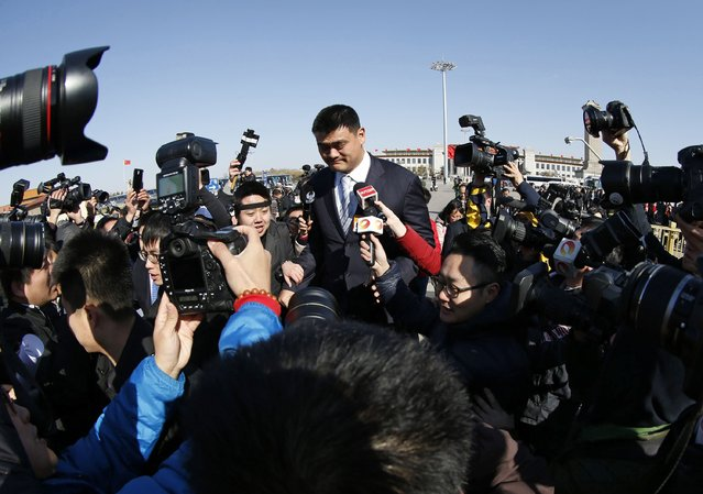 Former NBA player Yao Ming, also a delegate, arrives at the closing ceremony of the Chinese People's Political Consultative Conference (CPPCC) at the Great Hall of the People in Beijing, March 3, 2015. REUTERS/Kim Kyung-Hoon