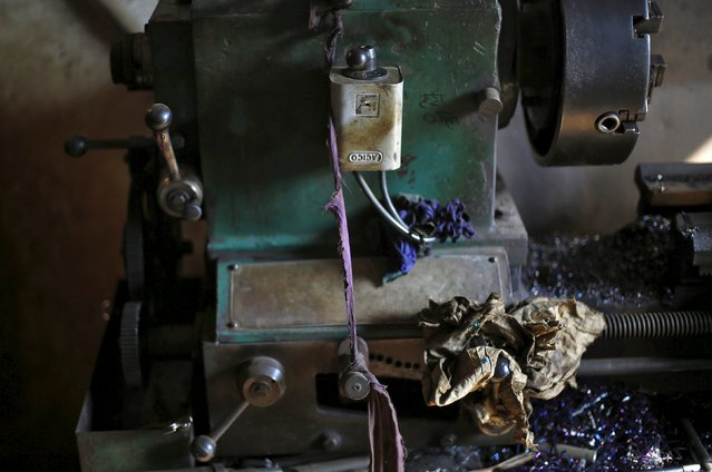 A part of a machine is tied with a cloth inside an auto parts workshop in Faridabad, India, December 24, 2015. (Photo by Adnan Abidi/Reuters)