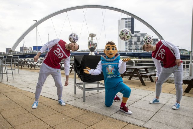 Handout photo provided by JSHPIX of the UEFA Euro 2020 Trophy at Clyde Arc in Glasgow with tournament mascot Skillizy and freestyler footballers on Thursday, June 3, 2021. (Photo by Jeff Holmes/PA Images via Getty Images)
