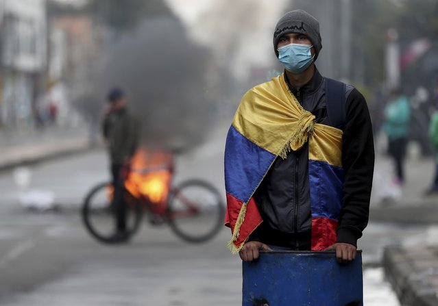 A demonstrator takes part in an anti-government protest triggered by proposed tax increases on public services, fuel, wages and pensions, in Bogota, Colombia, Wednesday, June 9, 2021. (Photo by Fernando Vergara/AP Photo)