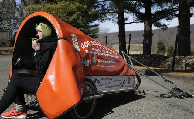 "Sixty-eight year old cross-country runner Rosie Swale-Pope bundles up against the morning chill while sitting in her cart, ""The Icebird"", in Upperville, Virginia March 13, 2015. (Photo by Gary Cameron/Reuters)"
