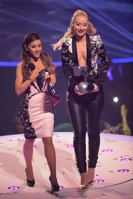 Iggy Azalea and Ariana Grande onstage during the MTV EMA's 2013 at the Ziggo Dome on November 10, 2013 in Amsterdam, Netherlands. (Photo by Ian Gavan/Getty Images for MTV)