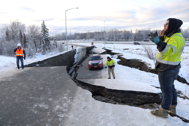 A stranded vehicle lies on a collapsed roadway near the airport after an earthquake in Anchorage, Alaska, U.S. November 30, 2018. (Photo by Nathaniel Wilder/Reuters)