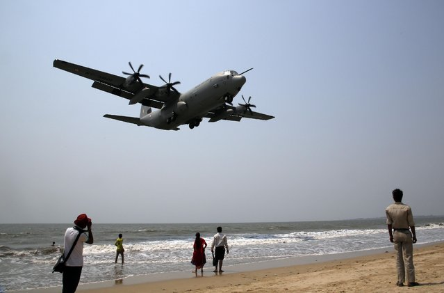 Indian Air Force's Hercules C-130J, prepares to land at the Juhu strip on the Arabian Sea coast as part of a terror preparedness exercise in Mumbai, India, Tuesday, March 24, 2015. (Photo by Rajanish Kakade/AP Photo)