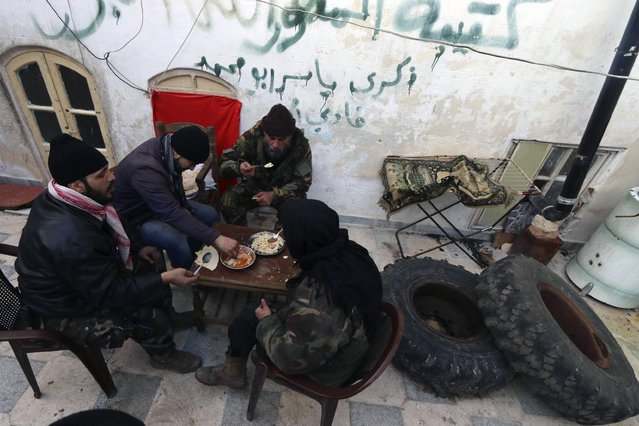 Free Syrian Army fighters eat their meal in Old Aleppo January 1, 2015. (Photo by Abdalrhman Ismail/Reuters)